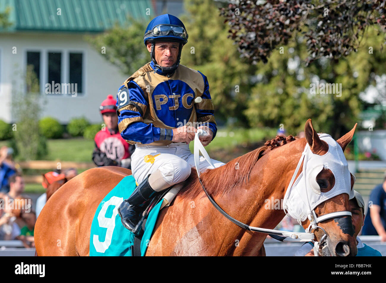 Close Up View of a Jockey Sitting on Horse,Monmouth Park Recetrack, Oceanport, New Jersey - Stock Image