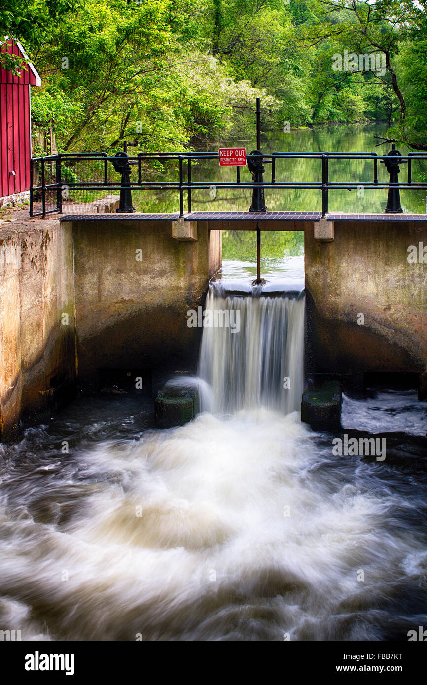 Water Rushing Through at a  Lock on The Deleware & Raritan Canal at Griggstown During Spring, Somerset County, - Stock Image