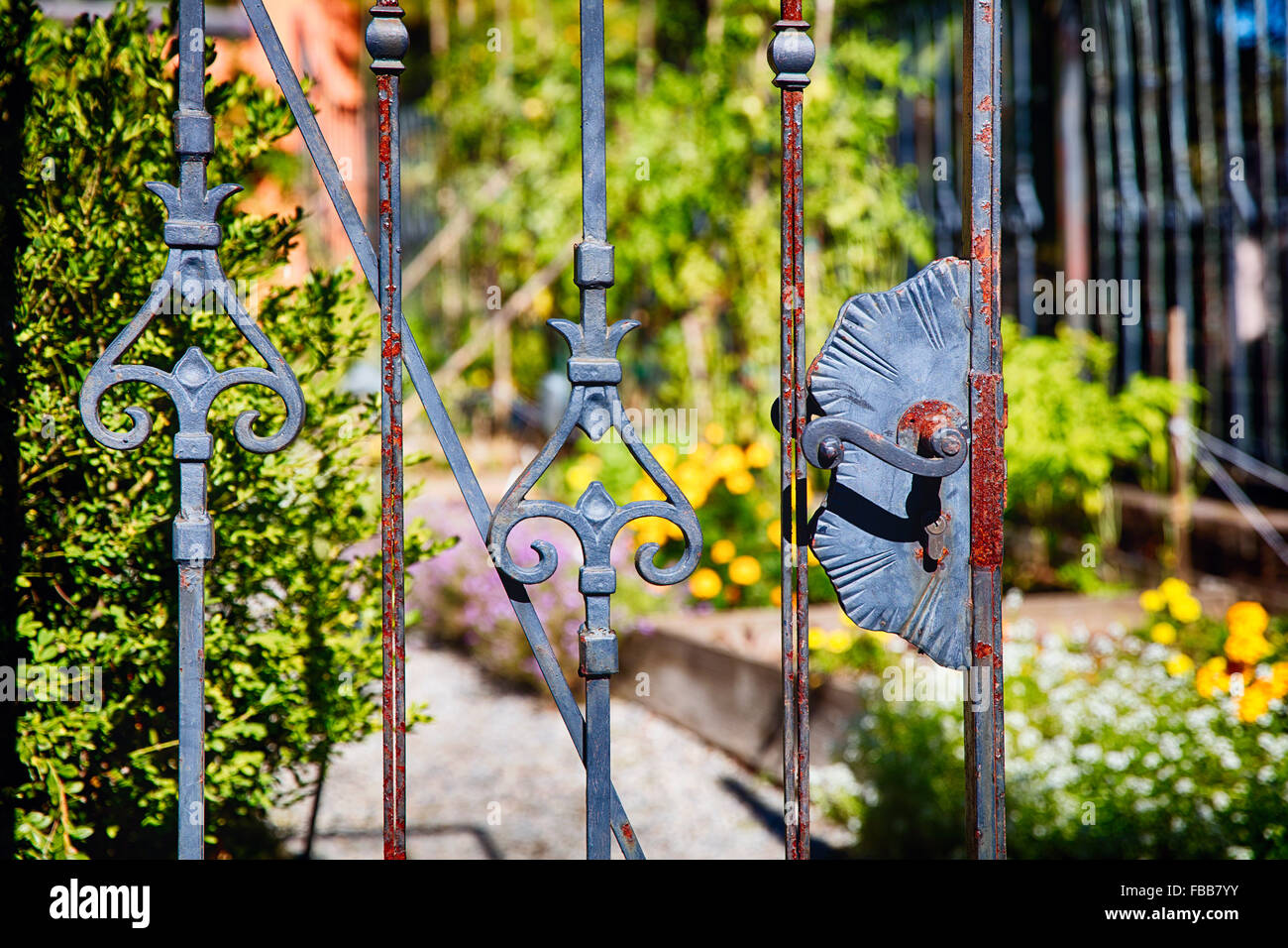 Close Up View of an Old Rusty Wrought Iron Garden Gate, Hamilton, New Jersey - Stock Image