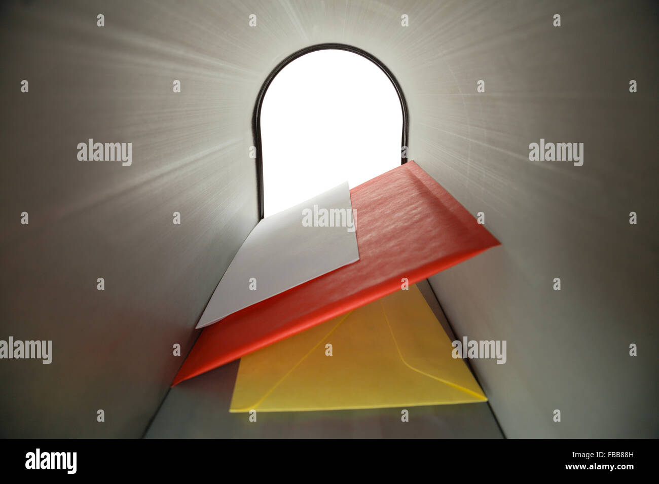 Three Blank Letters Inside Mailbox Looking Outward. - Stock Image