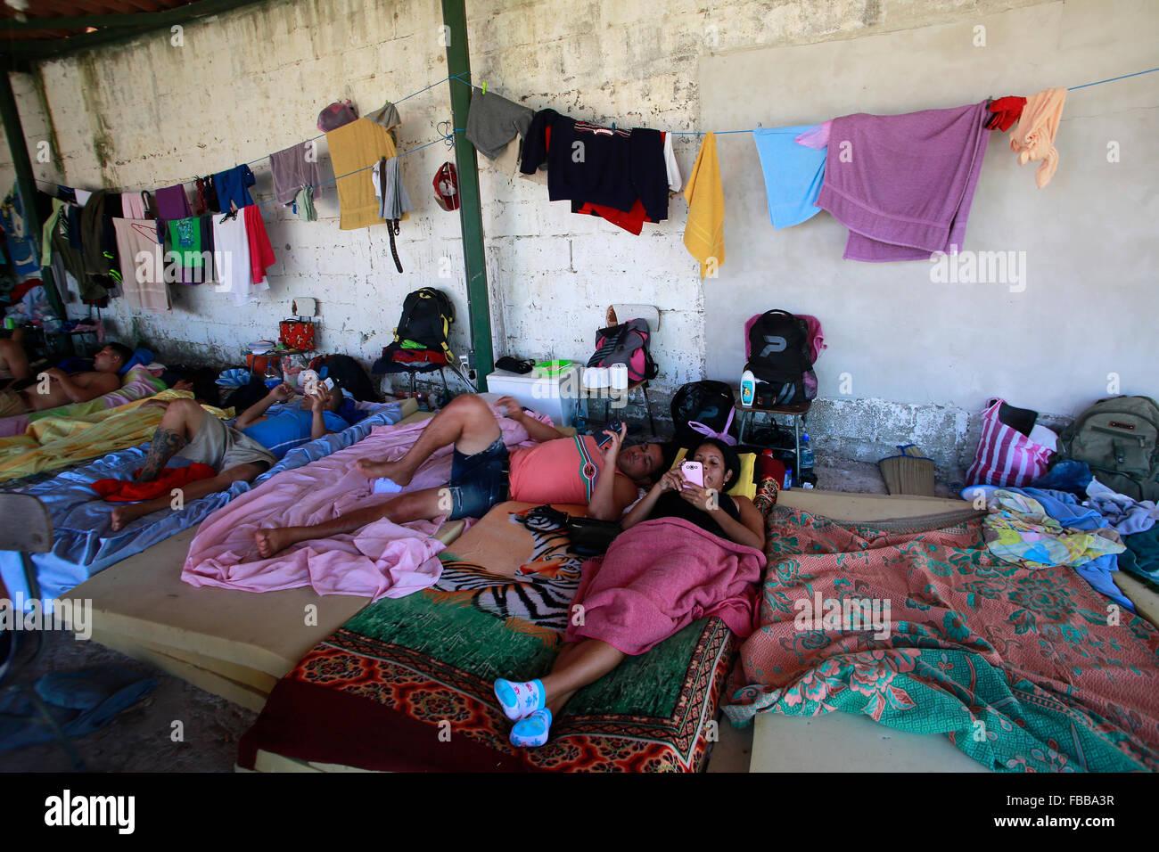 (160114) -- LA CRUZ, Jan. 14, 2016 (Xinhua) -- Cuban migrants rest at a shelter in La Cruz, Costa Rica, on Jan. Stock Photo