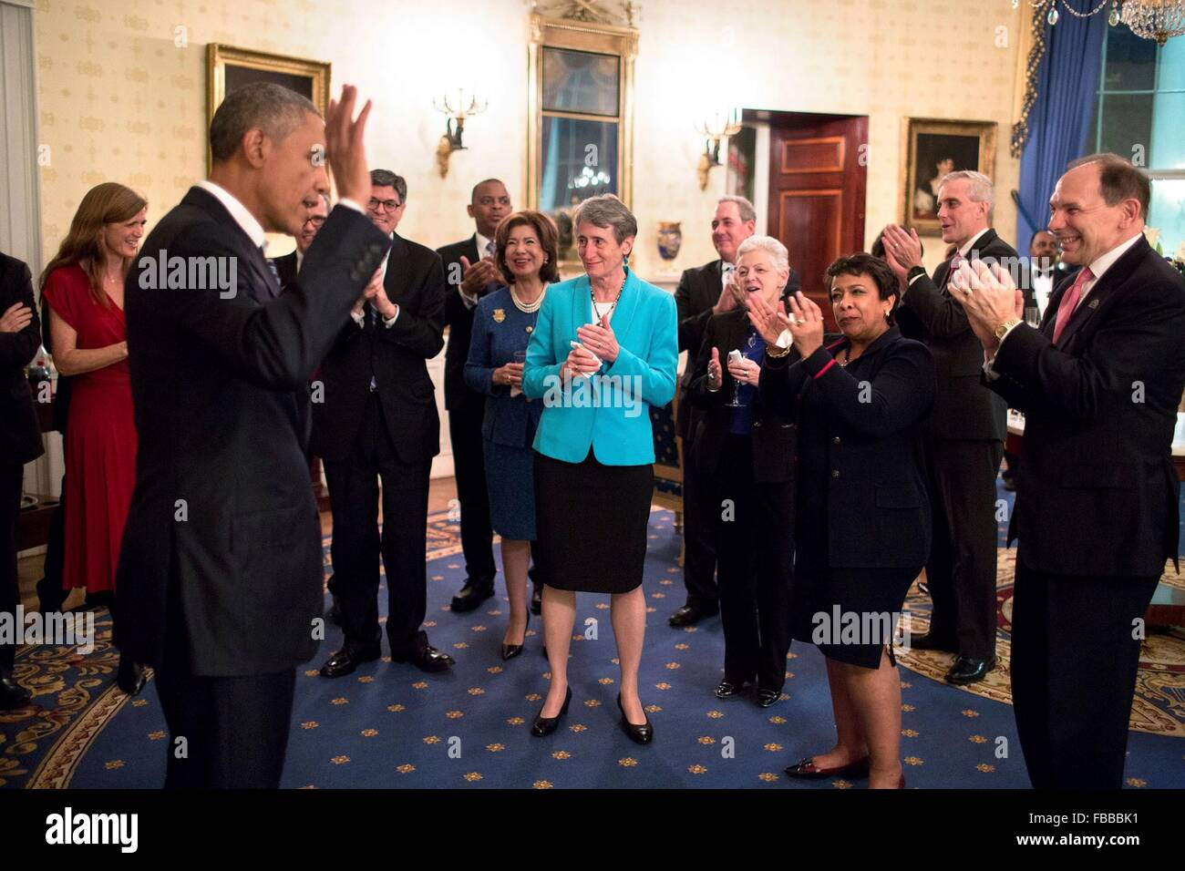 Washington DC, USA. 12th January, 2016. U.S President Barack Obama is congratulated by Cabinet members and staff - Stock Image