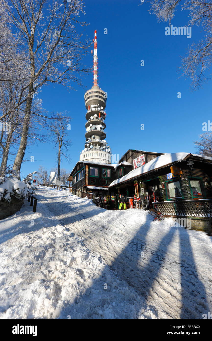 Sljeme mountain in winter. Television tower on Sljeme peak and Restourant in front - Stock Image