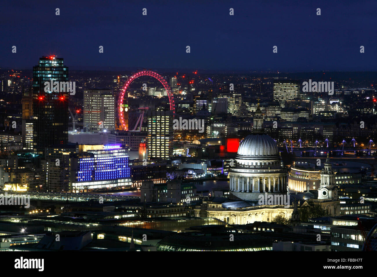 Skyline view of St Paul's Cathedral and the London Eye, London, UK - Stock Image