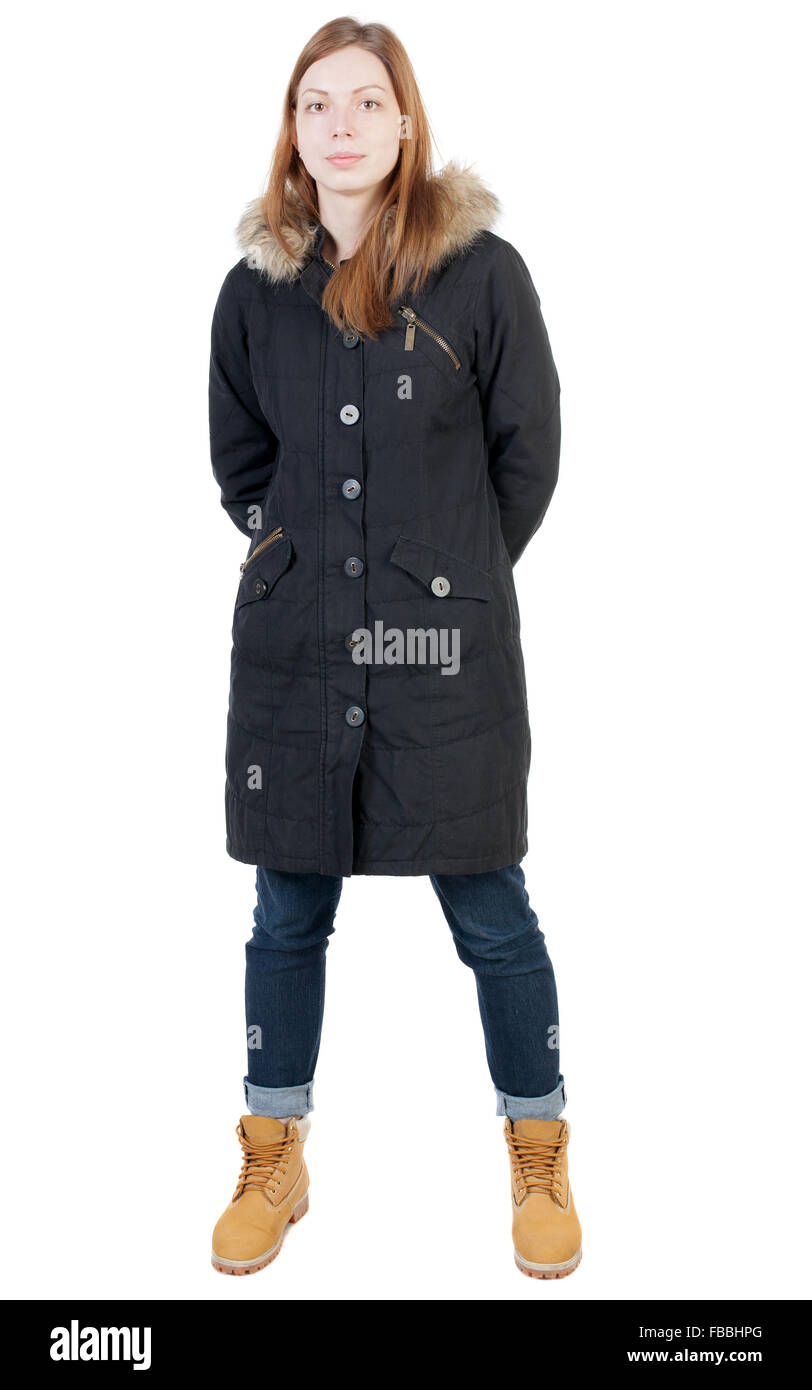 front view woman in winter jacket  looking up.   Standing young girl in parka.  Isolated over white background. - Stock Image