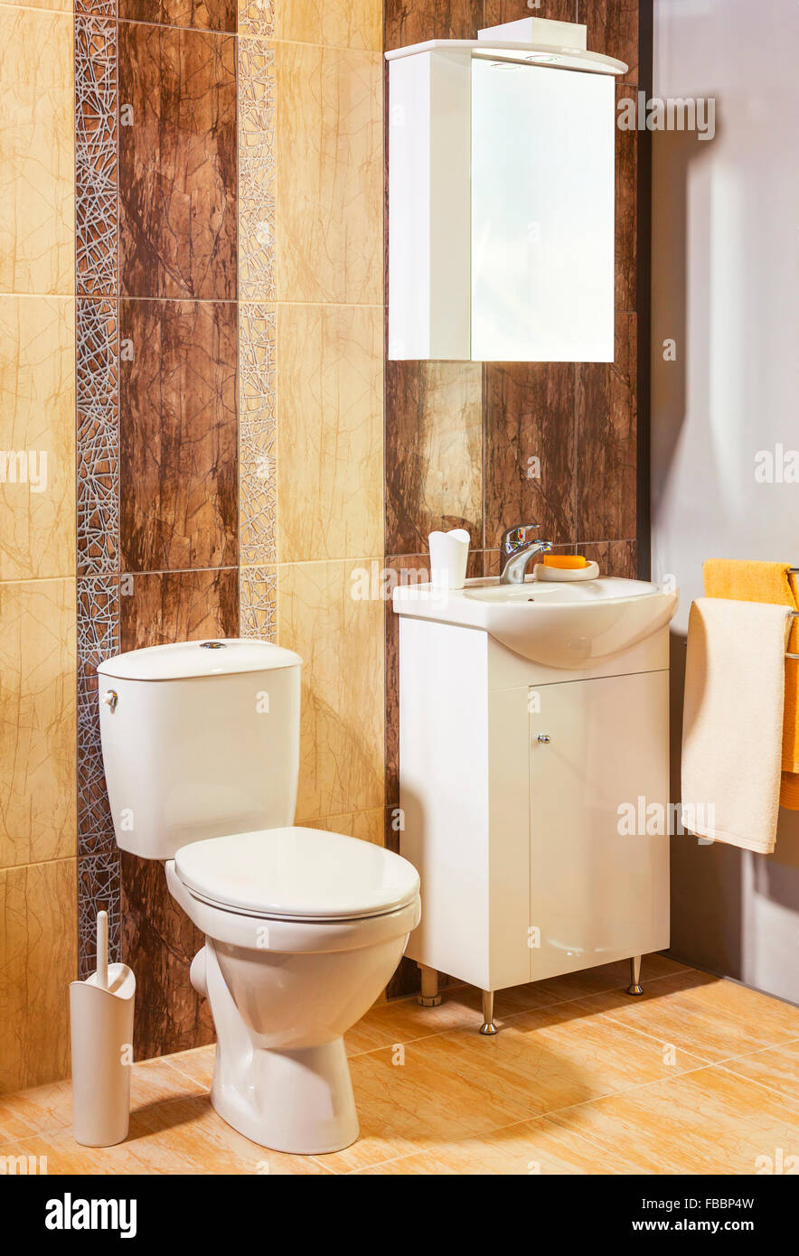 luxury bathroom with brown and orange tiles in apartment Stock Photo