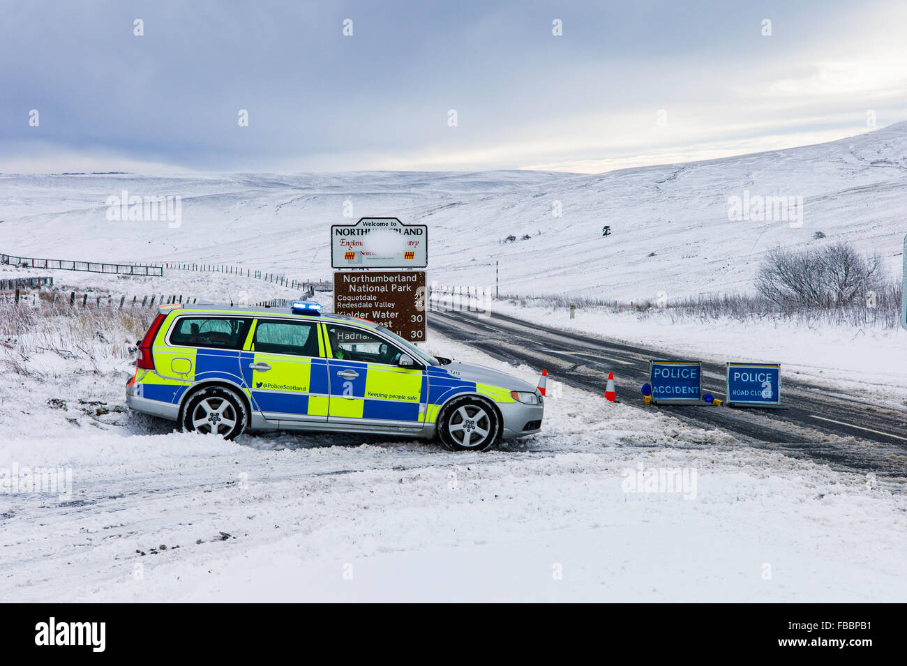 Carter Bar, Anglo Scot Border, UK. 14th January 2016. A Police roadblock on the A68 road which passes over the Carter - Stock Image