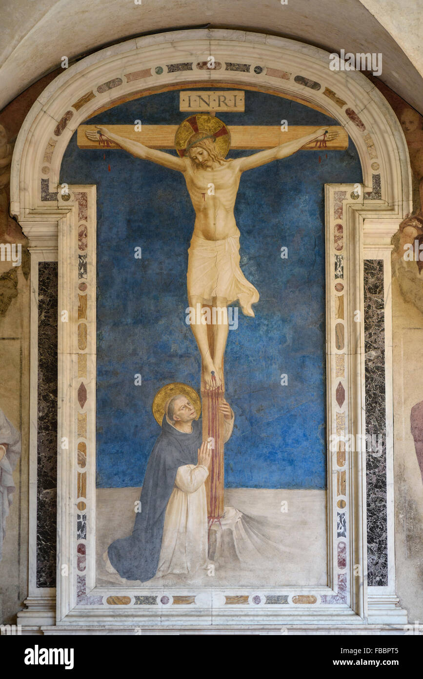 Florence. Italy. Christ on the Cross Adored by St Dominic, (ca. 1442), fresco by Fra Angelico, Museum of San Marco. - Stock Image