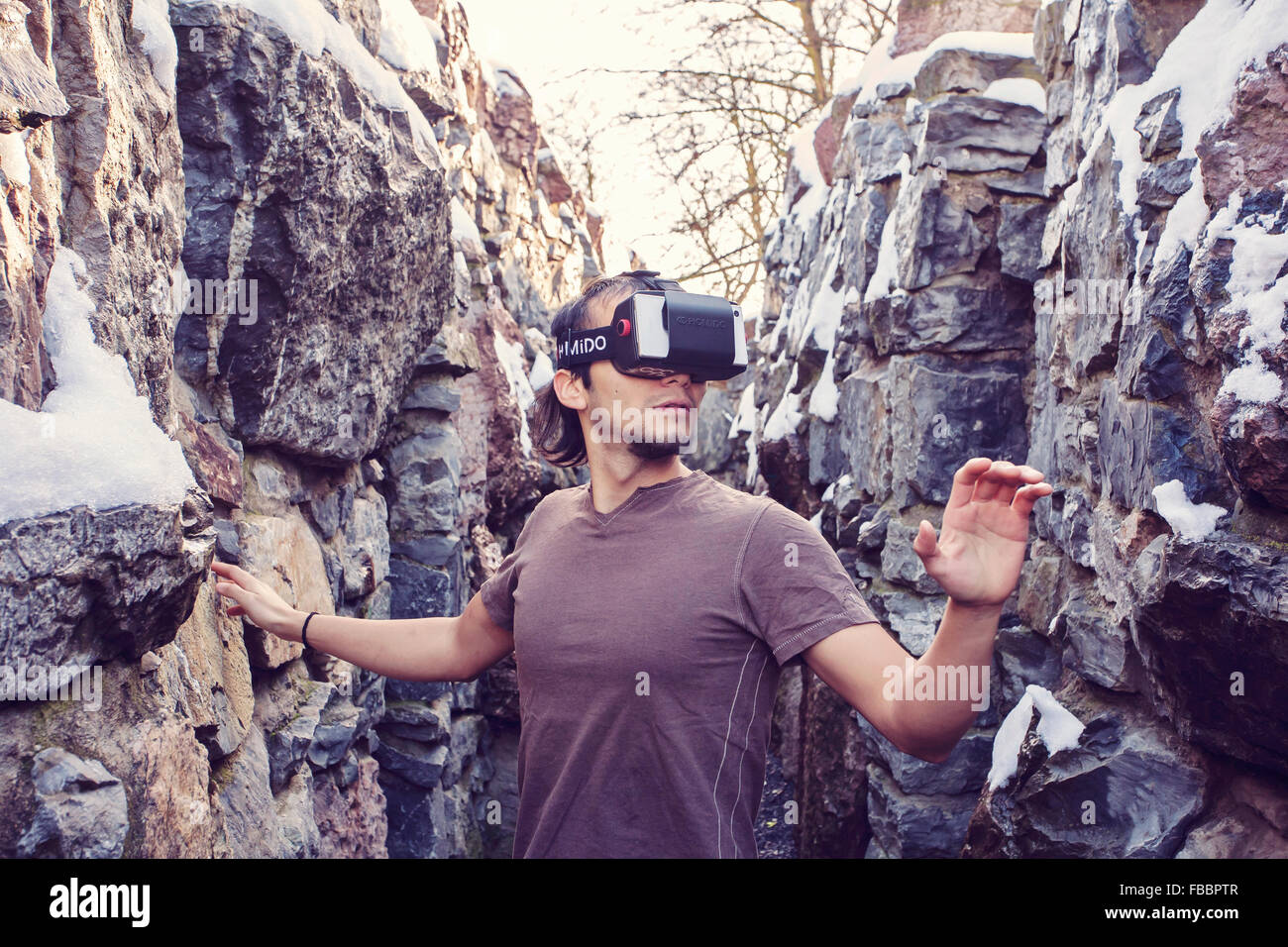 Young man with virtual reality glasses - Stock Image
