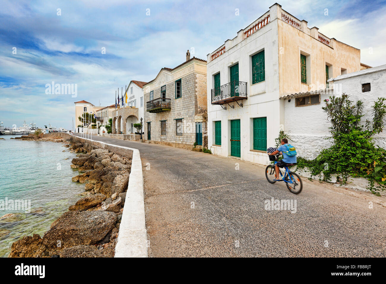A bicyclist in the town of Spetses island, Greece - Stock Image