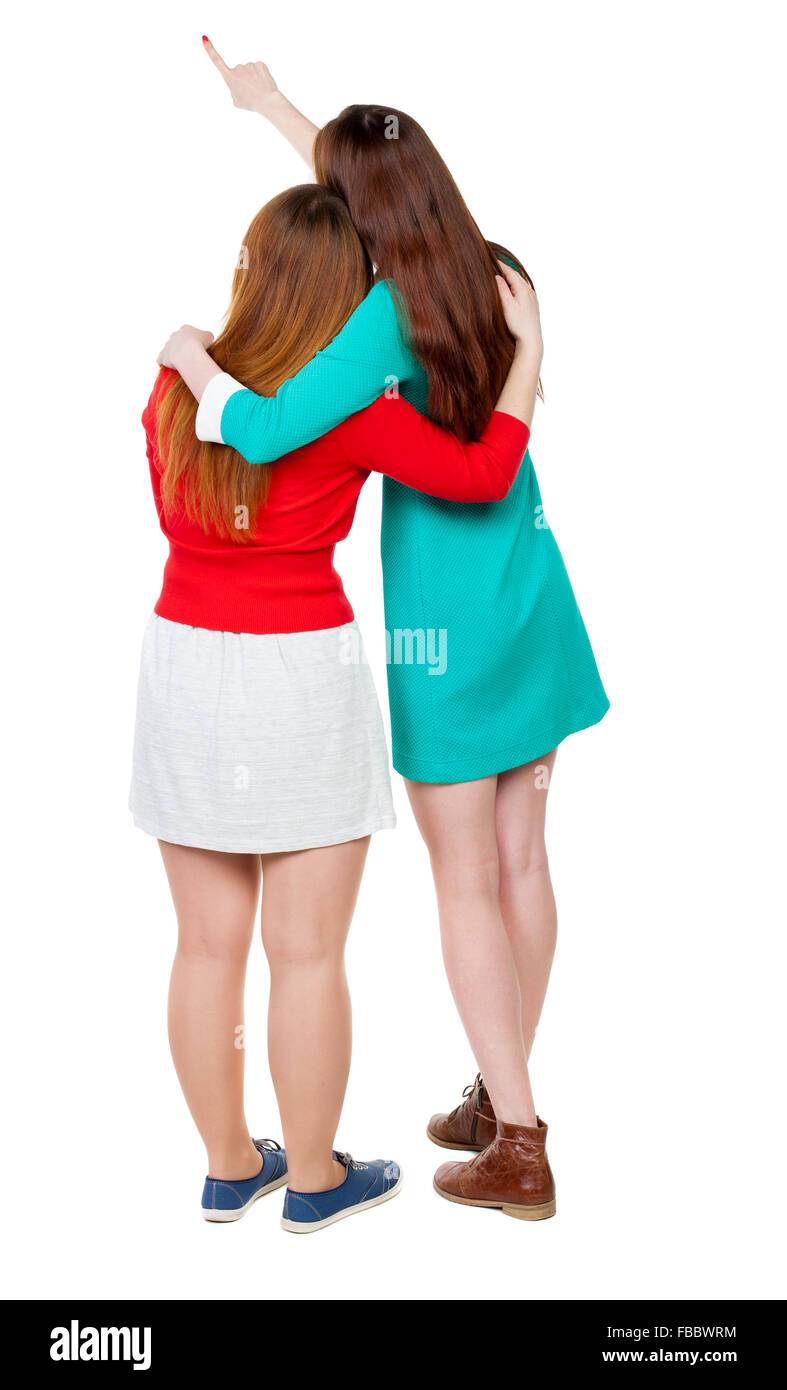 Two long haired friendly women pointing . backside view of person. Isolated over white background. Rear view people - Stock Image