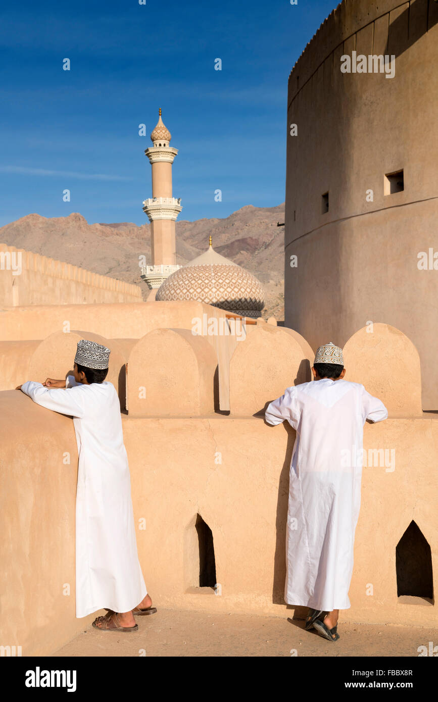 Omani schoolboys visiting Nizwa Fort in Nizwa Oman - Stock Image
