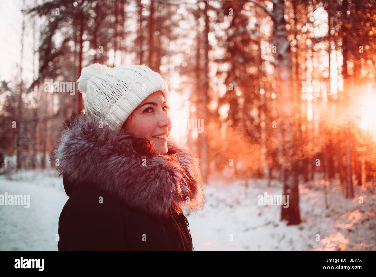 Pretty girl In the winter forest Stock Photo