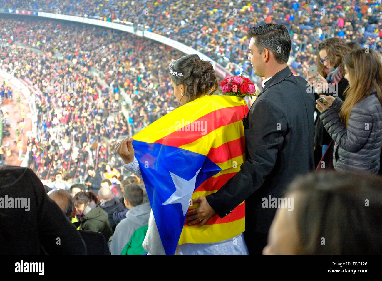 a newly married couple in the crowd at the nou camp/ camp nou stadium in barcelona during a copa del rey match - Stock Image