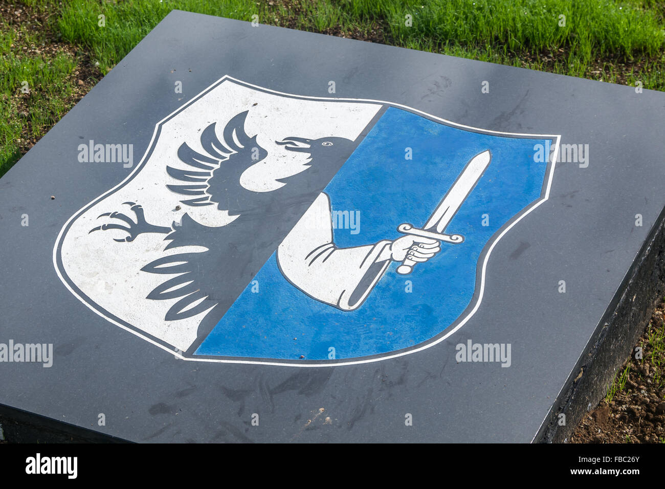 Provincial Flag of Connacht on stone work in IRA memorial garden in ST. James area of Belfast. - Stock Image