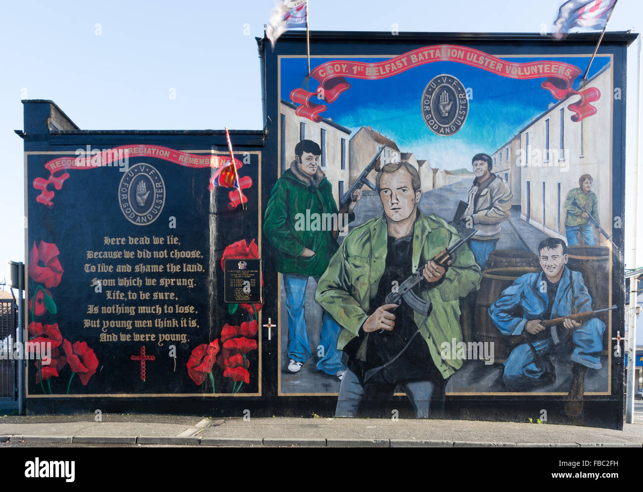 Large UVF mural shpwing local Volunteers who have died in the troubles, located on Belfast Shankill Road - Stock Image