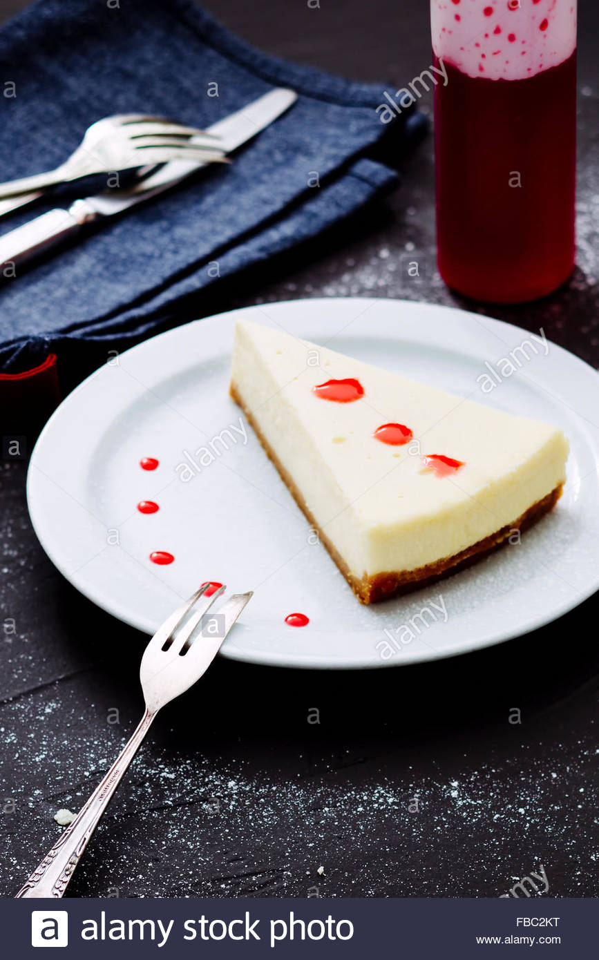 Slice of cheesecake served - Stock Image