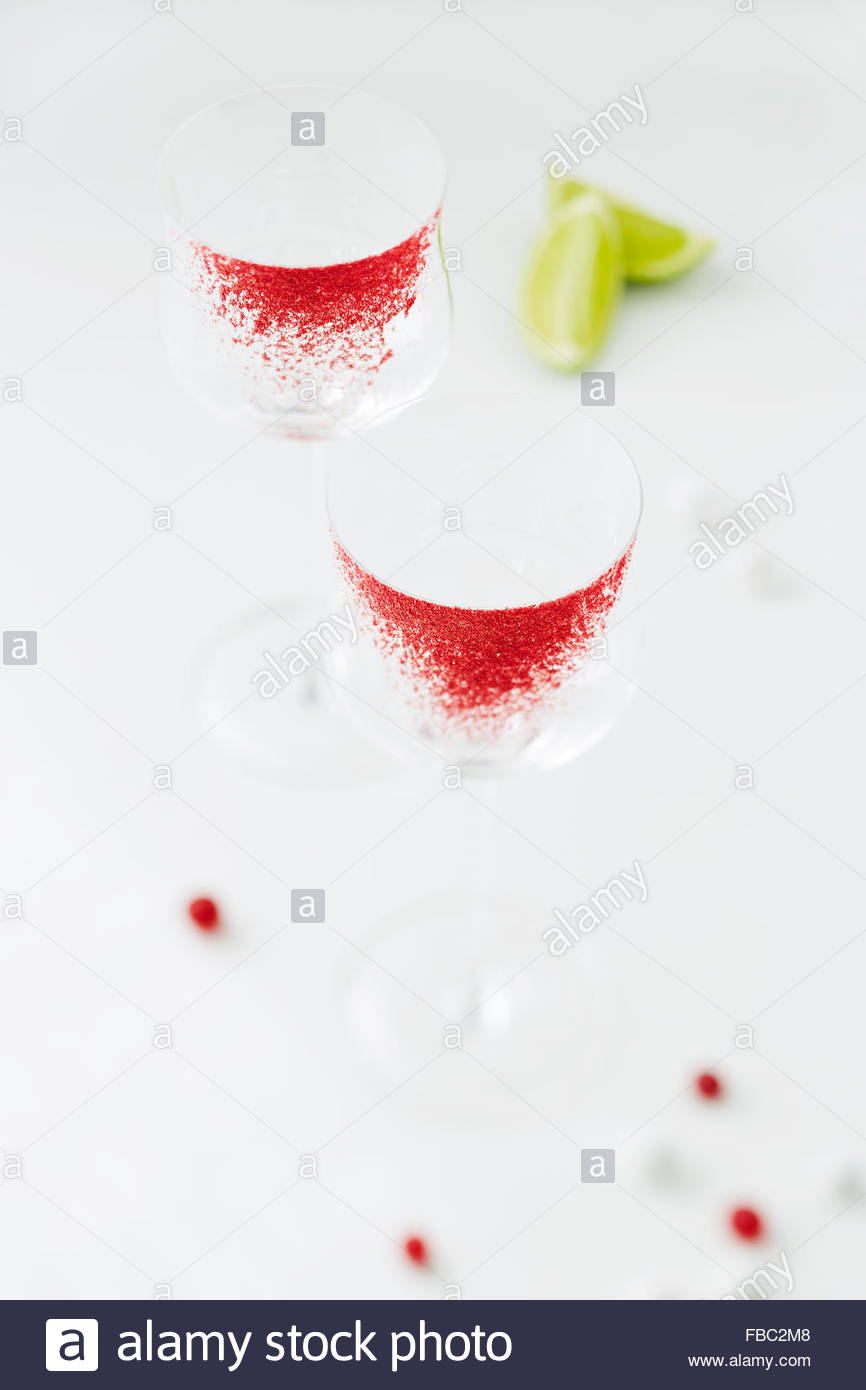 Cranberry-rimmed glass ready for serve coctail - Stock Image