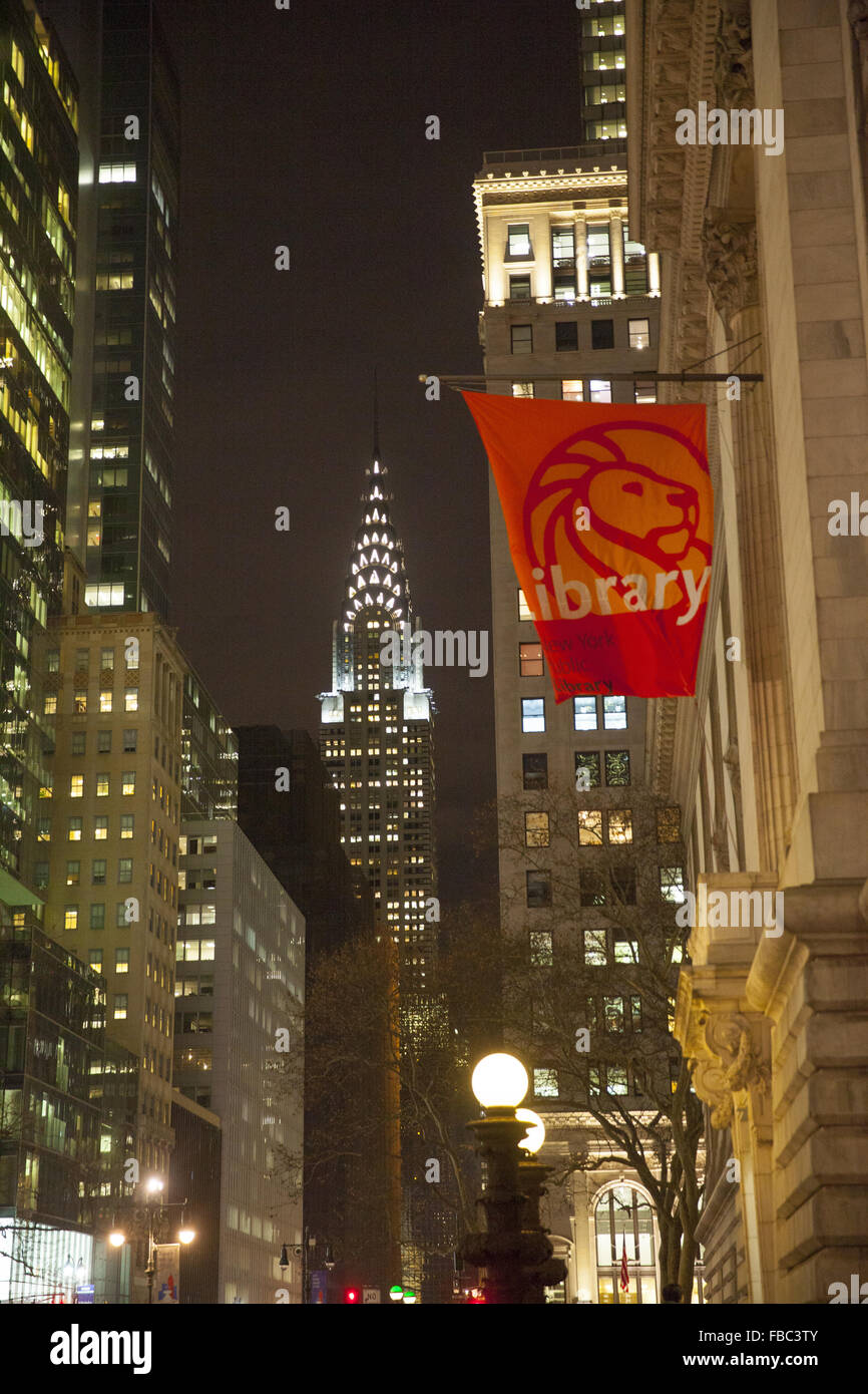 Looking east along 42nd St. from the the NY Public Library with the Chrysler building lit up in the background. - Stock Image