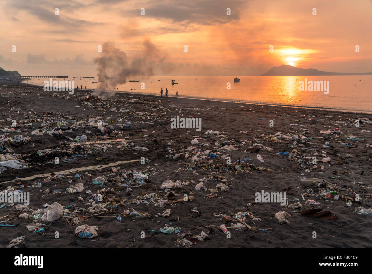 sunset at the polluted beach in Ende, Flores, Indonesia, Asia - Stock Image