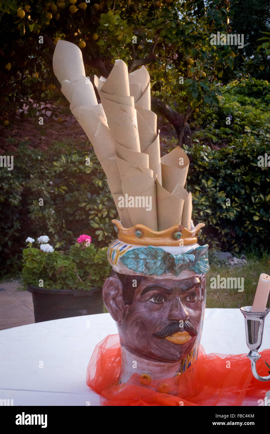 Bizarre napkin holder depicting the head of a black man. - Stock Image