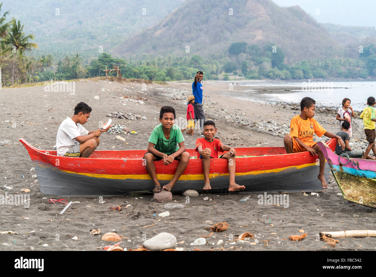 children in a fishing boat at the beach in Ende, Flores, Indonesia, Asia Stock Photo