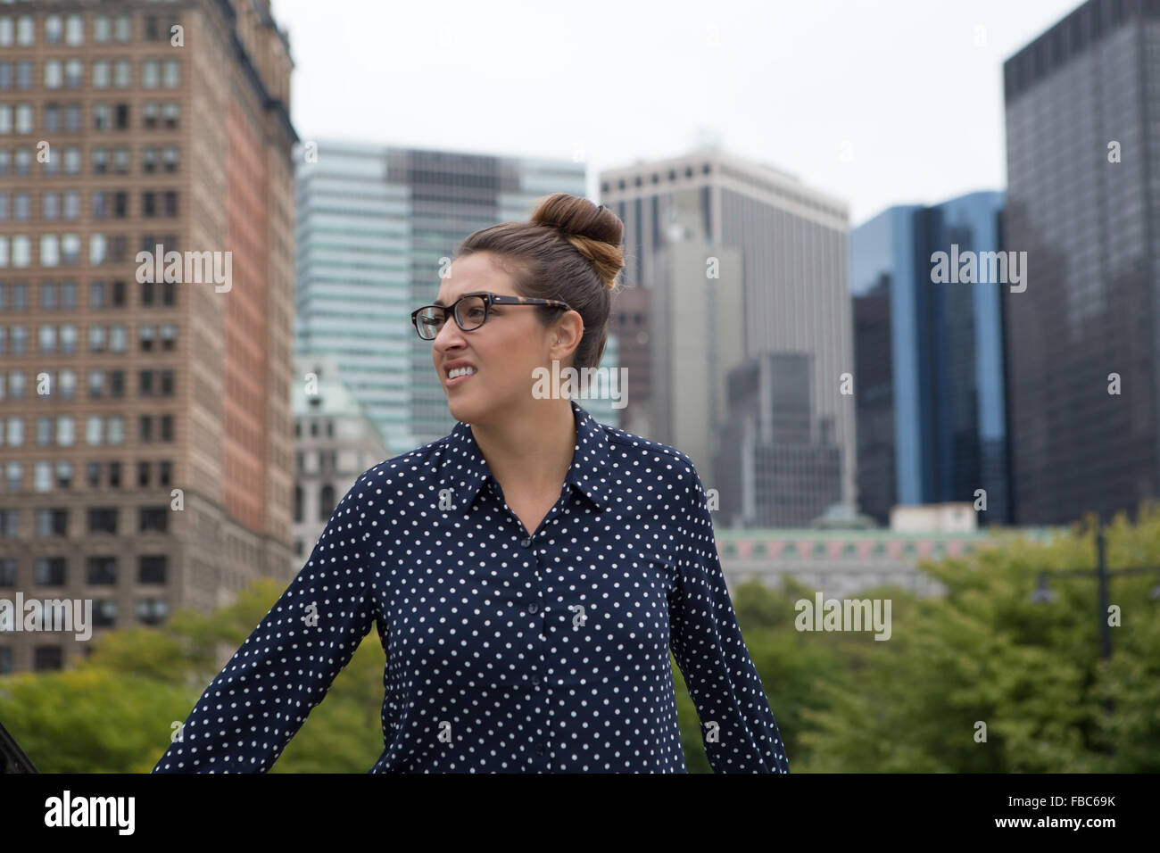 A young professional business woman walking in the city. Photographed in New York City, in October 2015. - Stock Image
