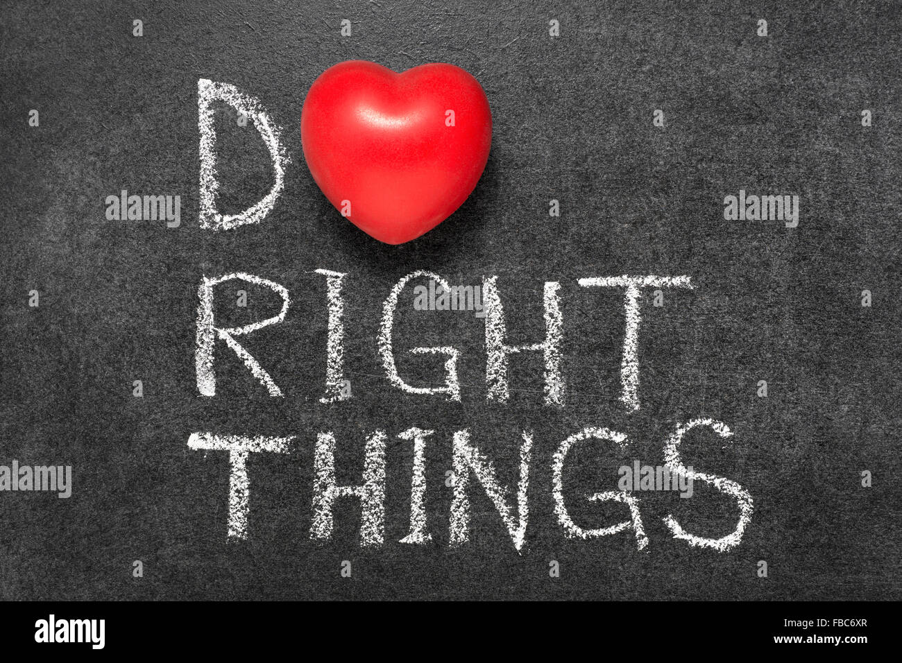 do right things phrase handwritten on blackboard with heart symbol instead O - Stock Image