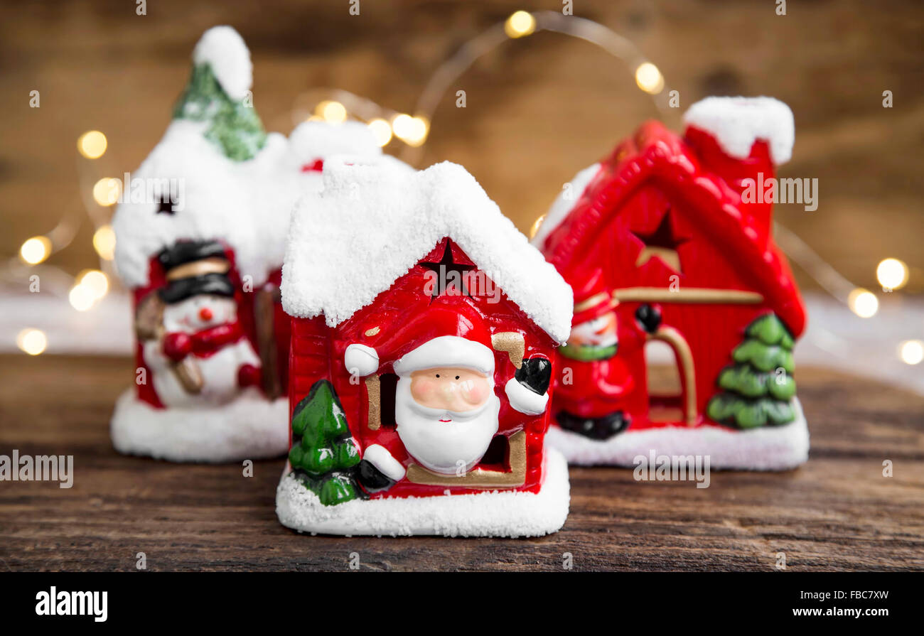 Christmas houses decorations and candle holders with festive lights - Stock Image