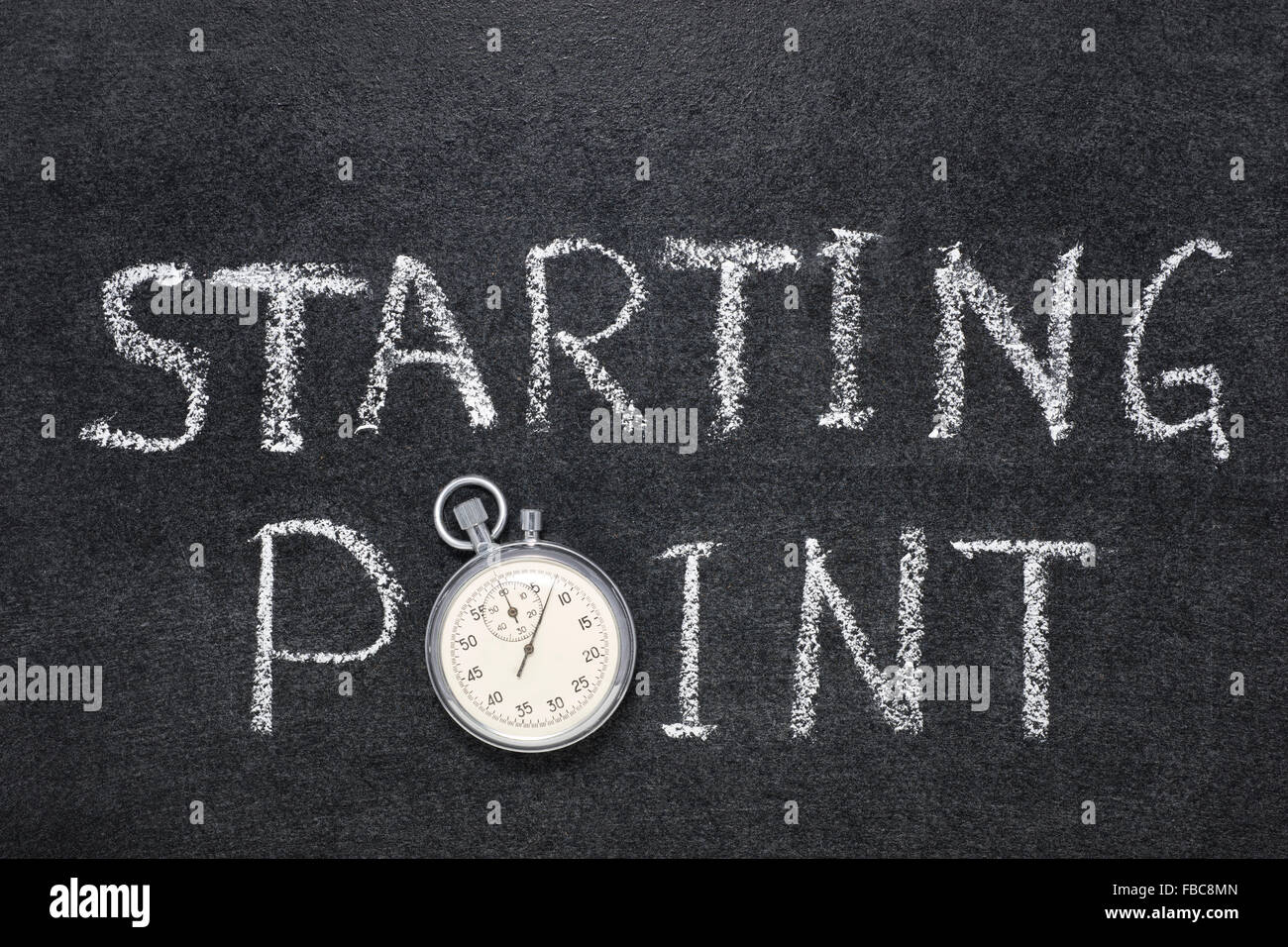 starting point phrase handwritten on chalkboard with vintage precise stopwatch used instead of O - Stock Image
