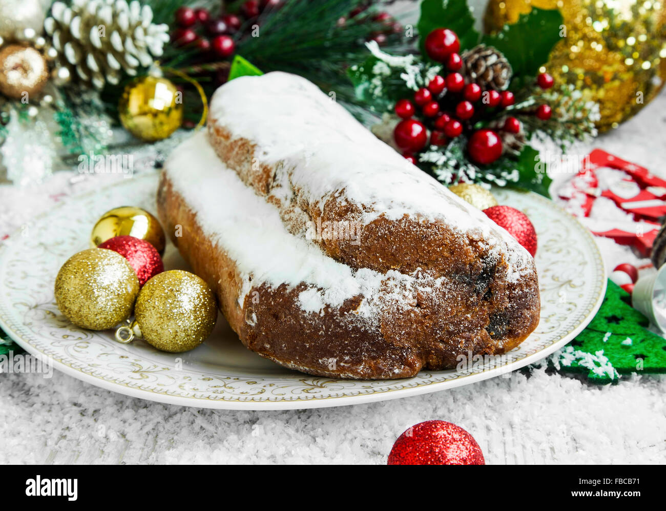 Christmas Cake ,Stolen Traditional Christmas Cake with Festive Ornaments - Stock Image