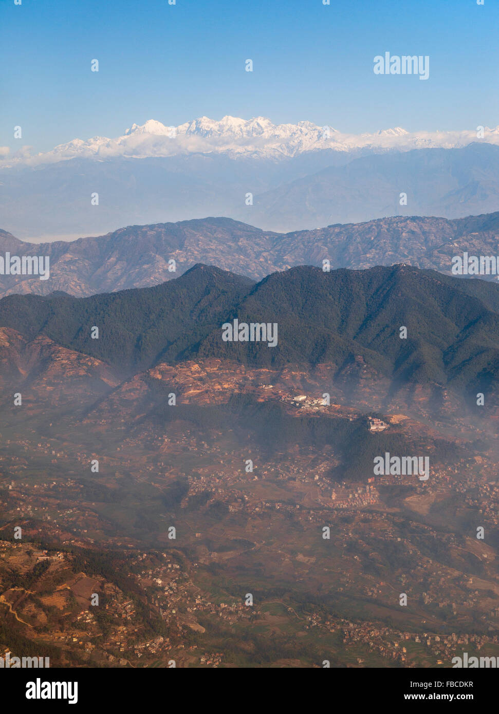 Aerial view of Kathmandu, foothills and himalayan mountain backdrop - Stock Image