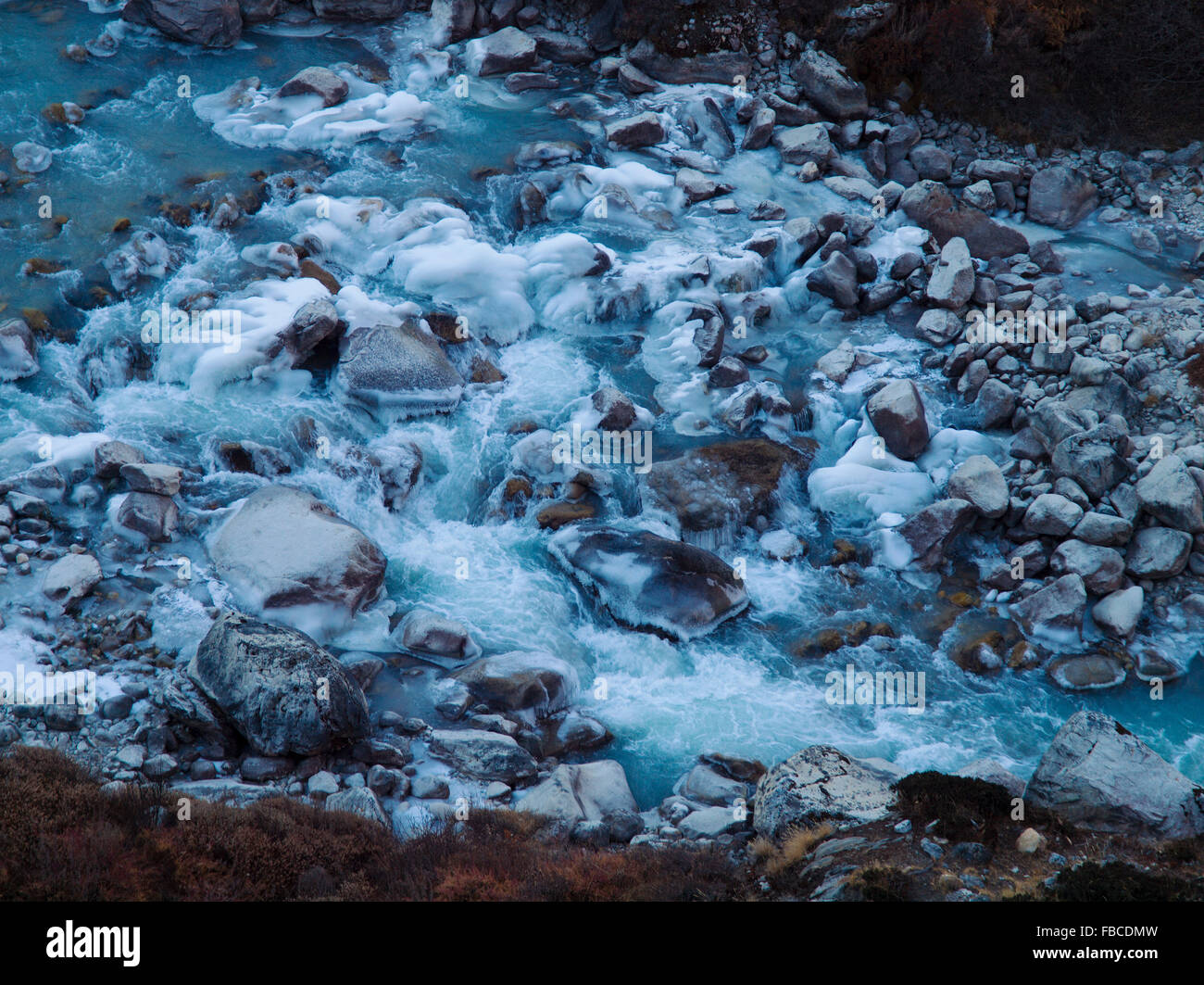 Frozen boulders in river, Khumbu region Nepal - Stock Image