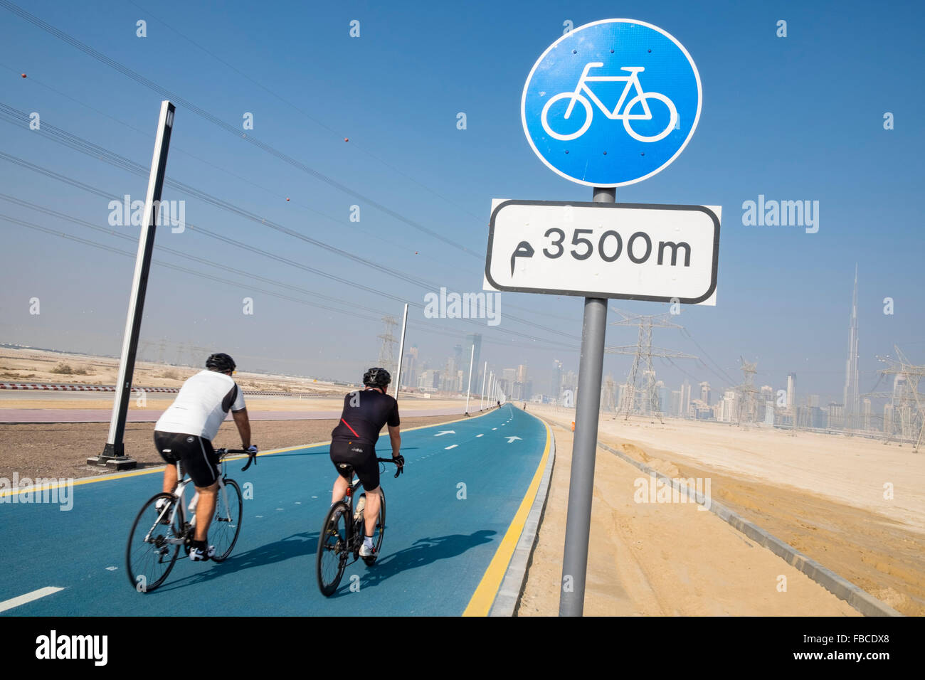 Cyclists on new cycle track at District One at new property development in Dubai United Arab Emirates - Stock Image