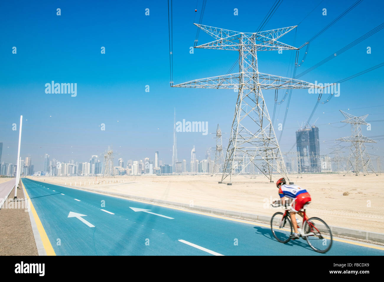 Cyclist on new cycle track at District One at new property development in Dubai United Arab Emirates - Stock Image