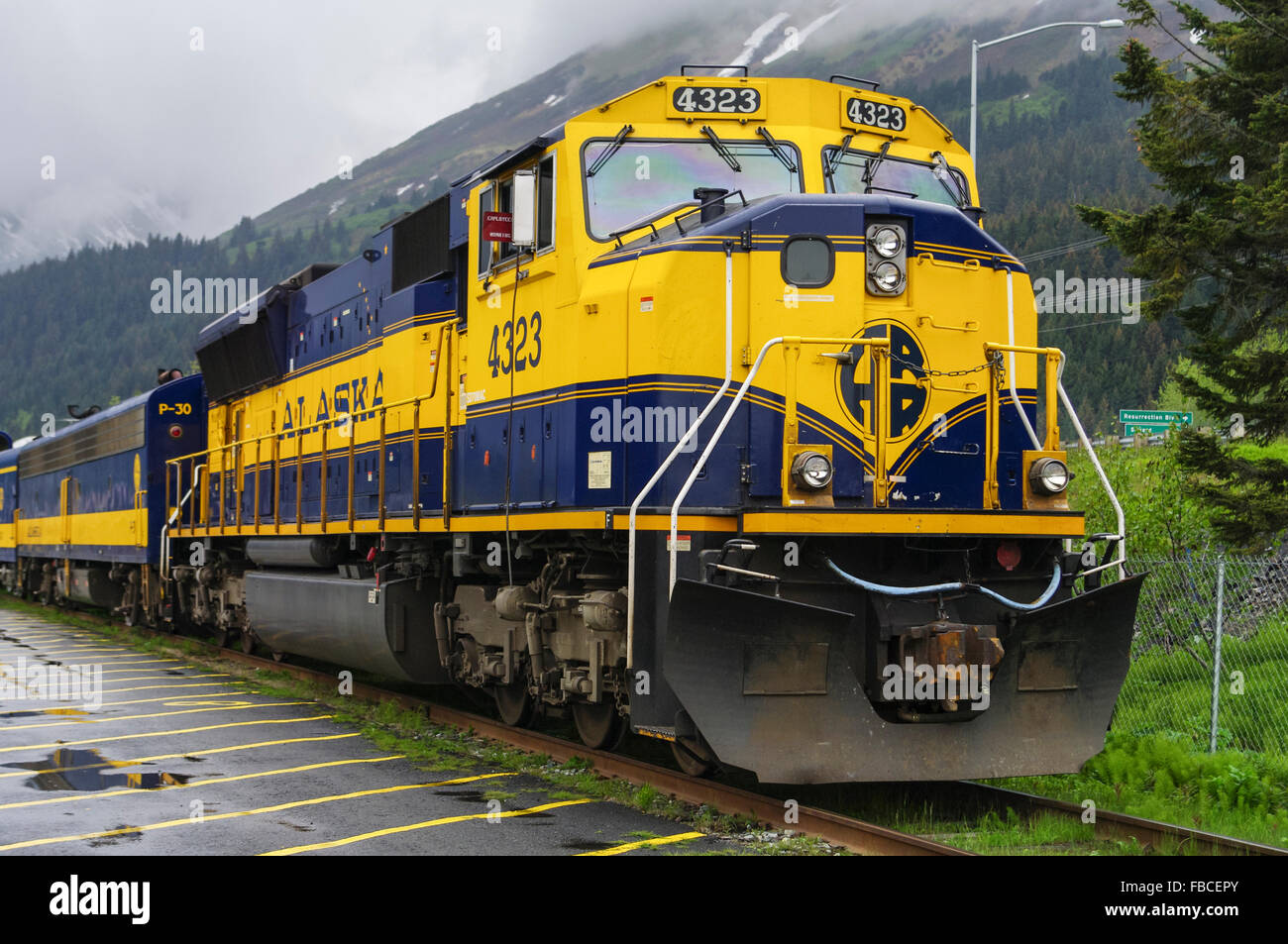 EMD SD70MAC diesel locomotive of the Alaska Railroad, registration number 4323, in yellow and blue ARR livery. Seward, - Stock Image