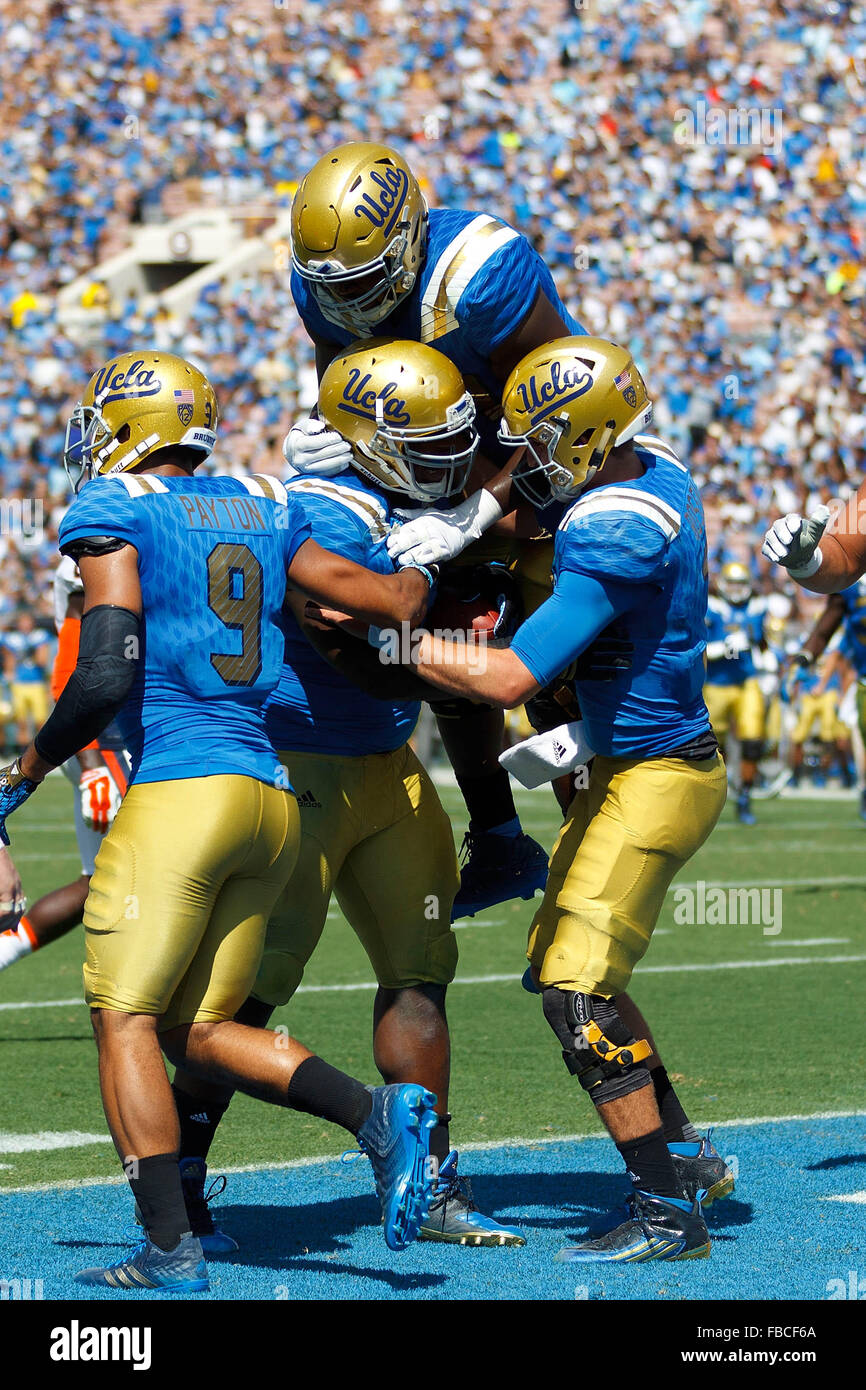 Defensive lineman Kenny Clark #97 of the UCLA Bruins is congratulated by teammates after scoring a touchdown against - Stock Image