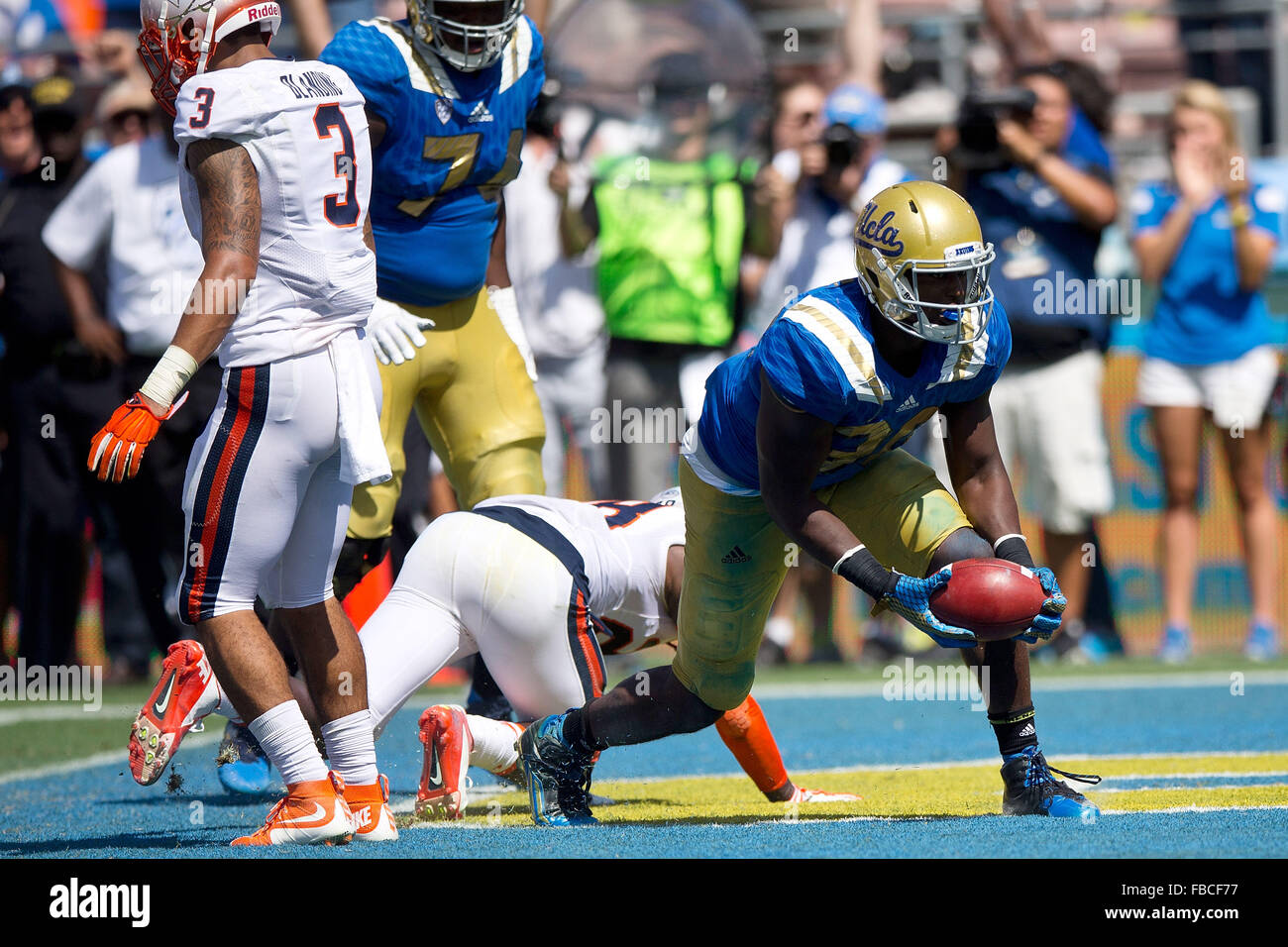 Linebacker Myles Jack #30 of the UCLA Bruins scores a touchdown against the Virginia Cavaliers during the third - Stock Image