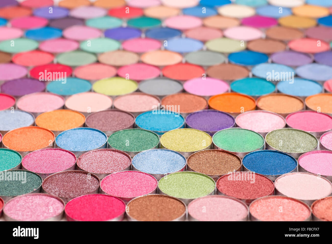 Background with large group of colored eyeshadow - Stock Image