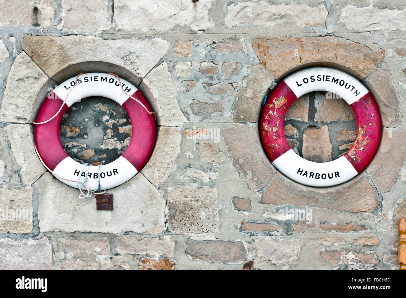 Two red and white emergency flotation devices at Lossiemouth harbour in Scotland Stock Photo