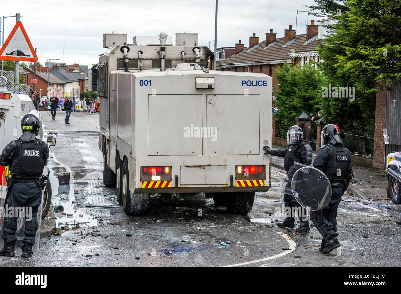 PSNI water cannon being deployed during Irish Republican riot in Belfast - Stock Image