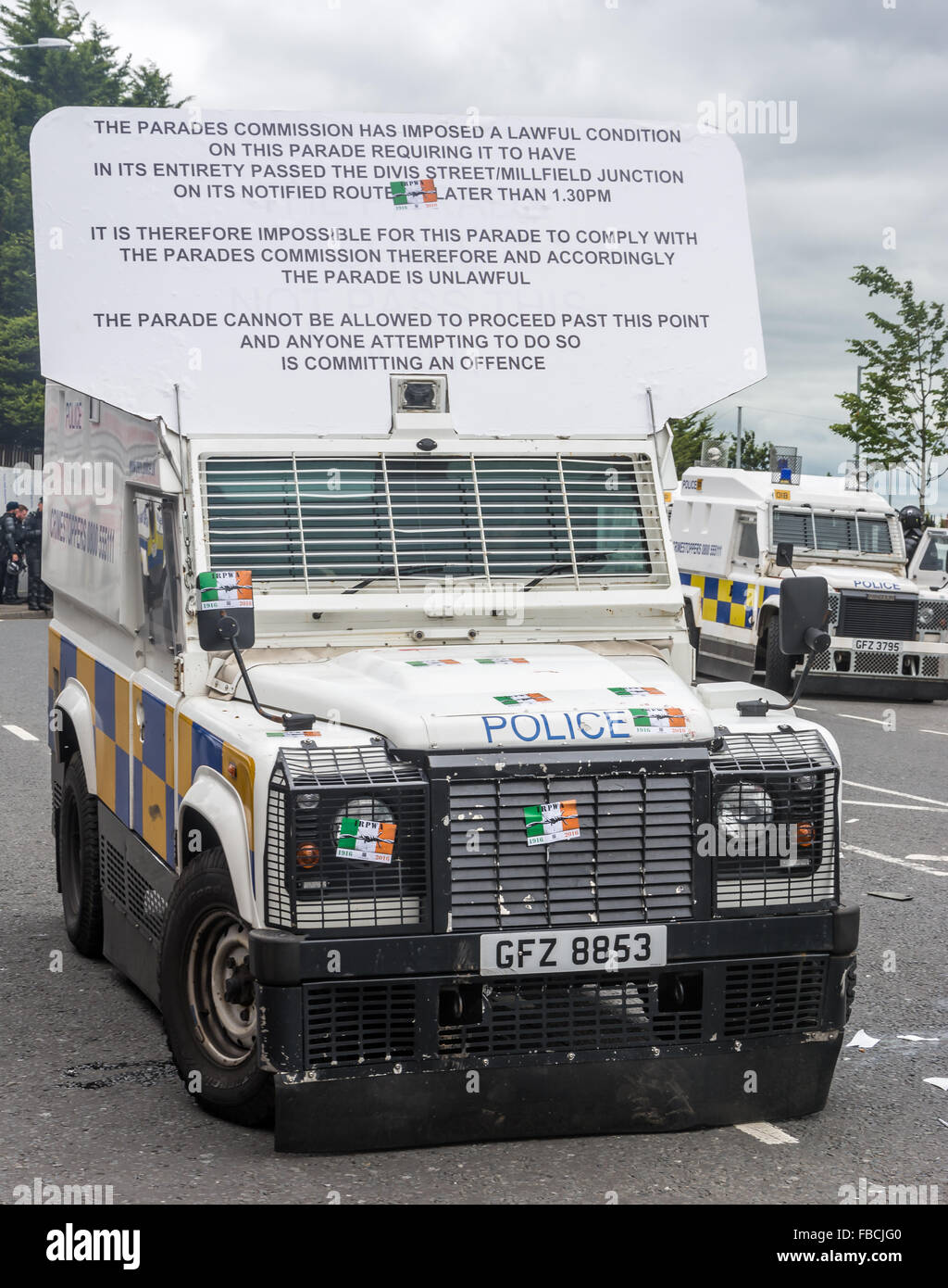 PSNI land rover displaying a Parades Commission parade ruling in Belfast. The land rover had stickers placed on - Stock Image