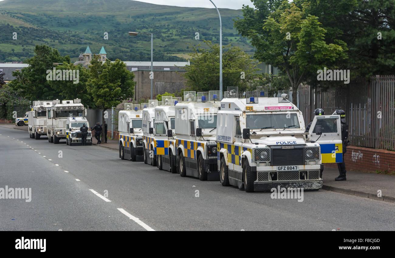 b5da9afaa5 Line of PSNI armoured landrovers prepare for trouble in North Belfast -  Stock Image