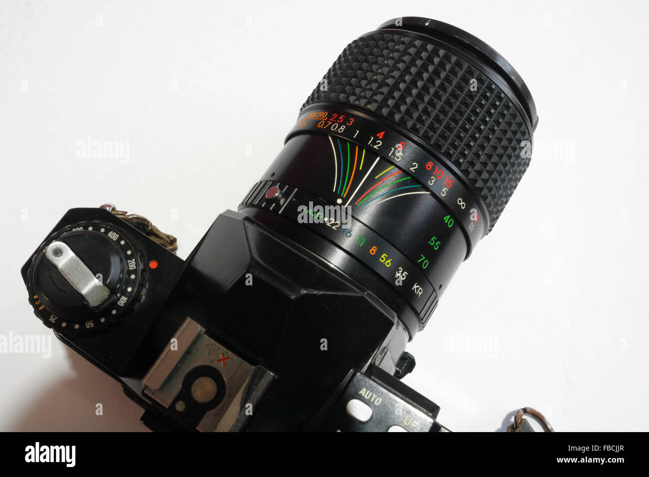 Film SLR camera with zoom lens showing depth of field scale - Stock Image