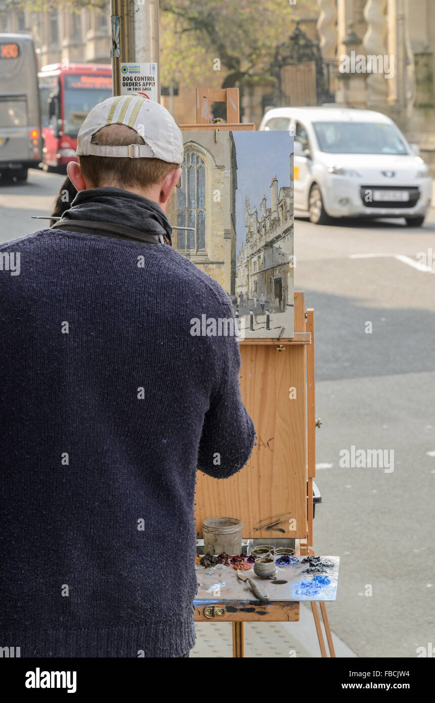 An artist painting Plein Air in High Street, Oxford, England, United Kingdom. Stock Photo