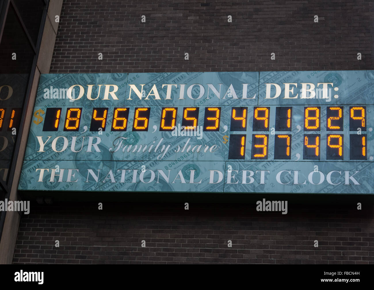 The National Debt Clock shows the state of the country and world economy, located in New York City - Stock Image