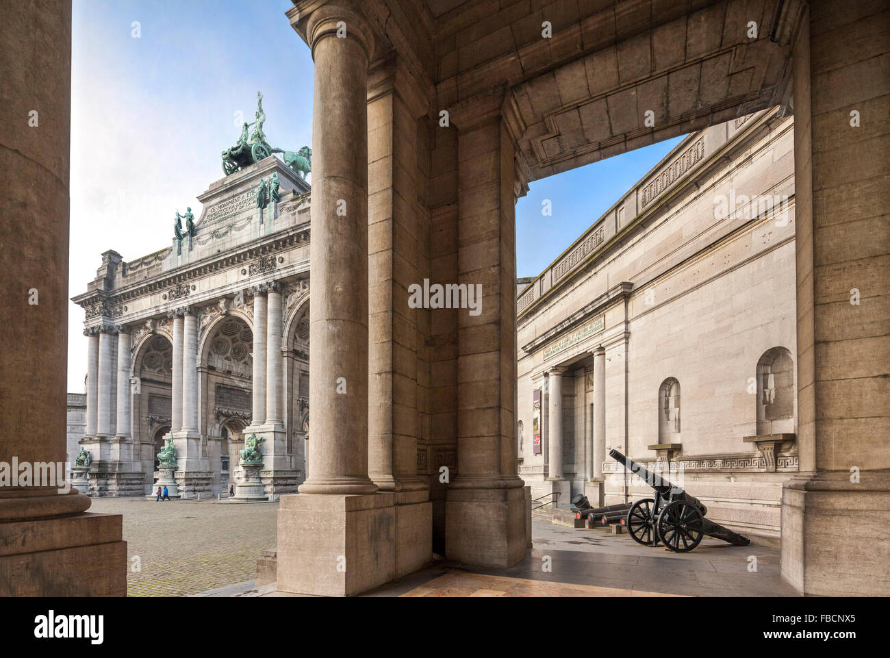 Brussels entrance of the War Museum and Jubilee Triumphal Arch in the Cinquantenaire or Jubilee Park - Stock Image