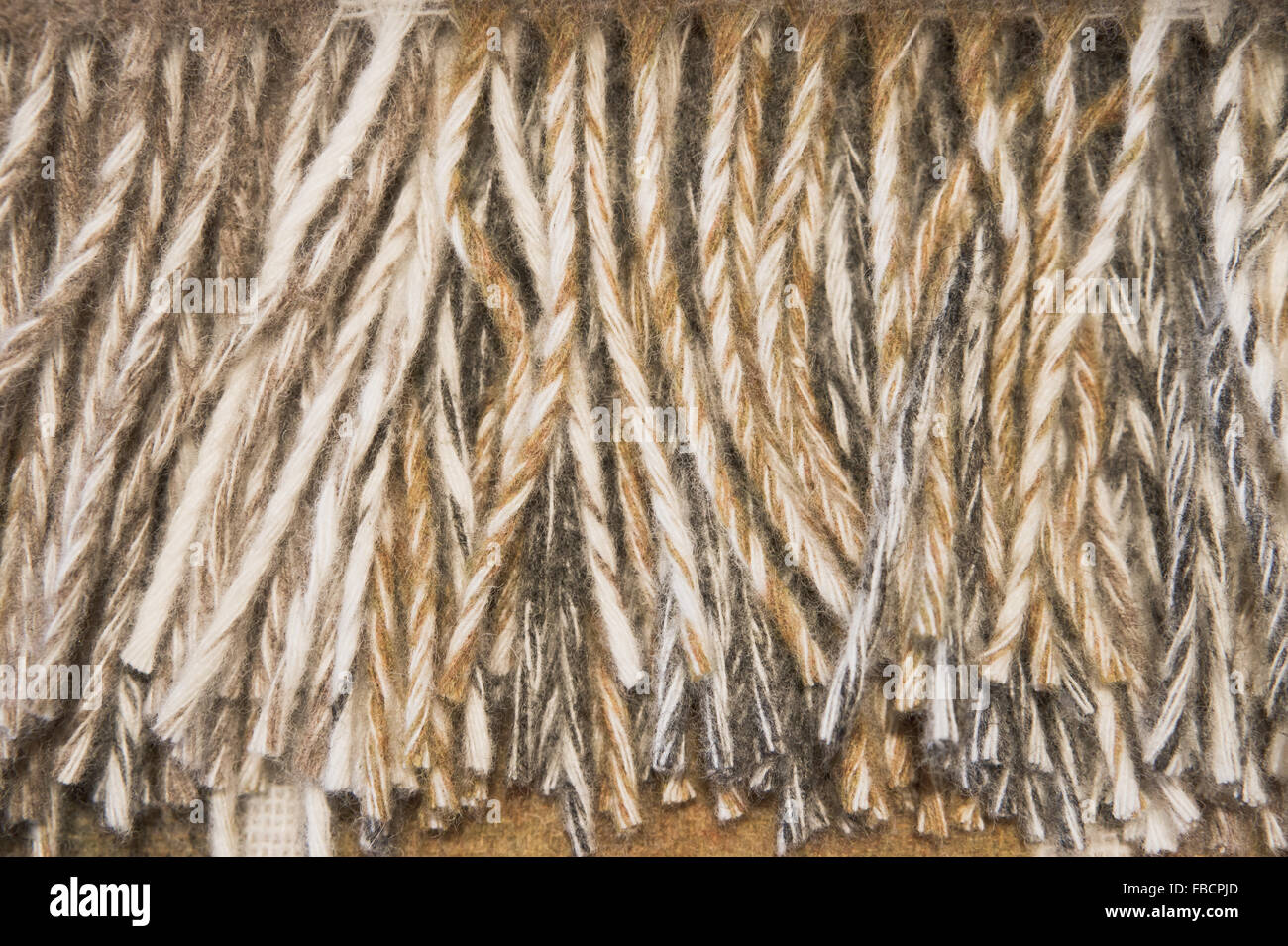 Part of the fringe of a wool blanket - Stock Image