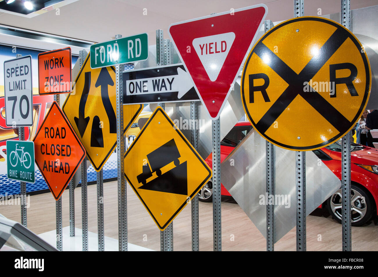 Detroit, Michigan - Road signs in the Ford display at the North American International Auto Show. - Stock Image
