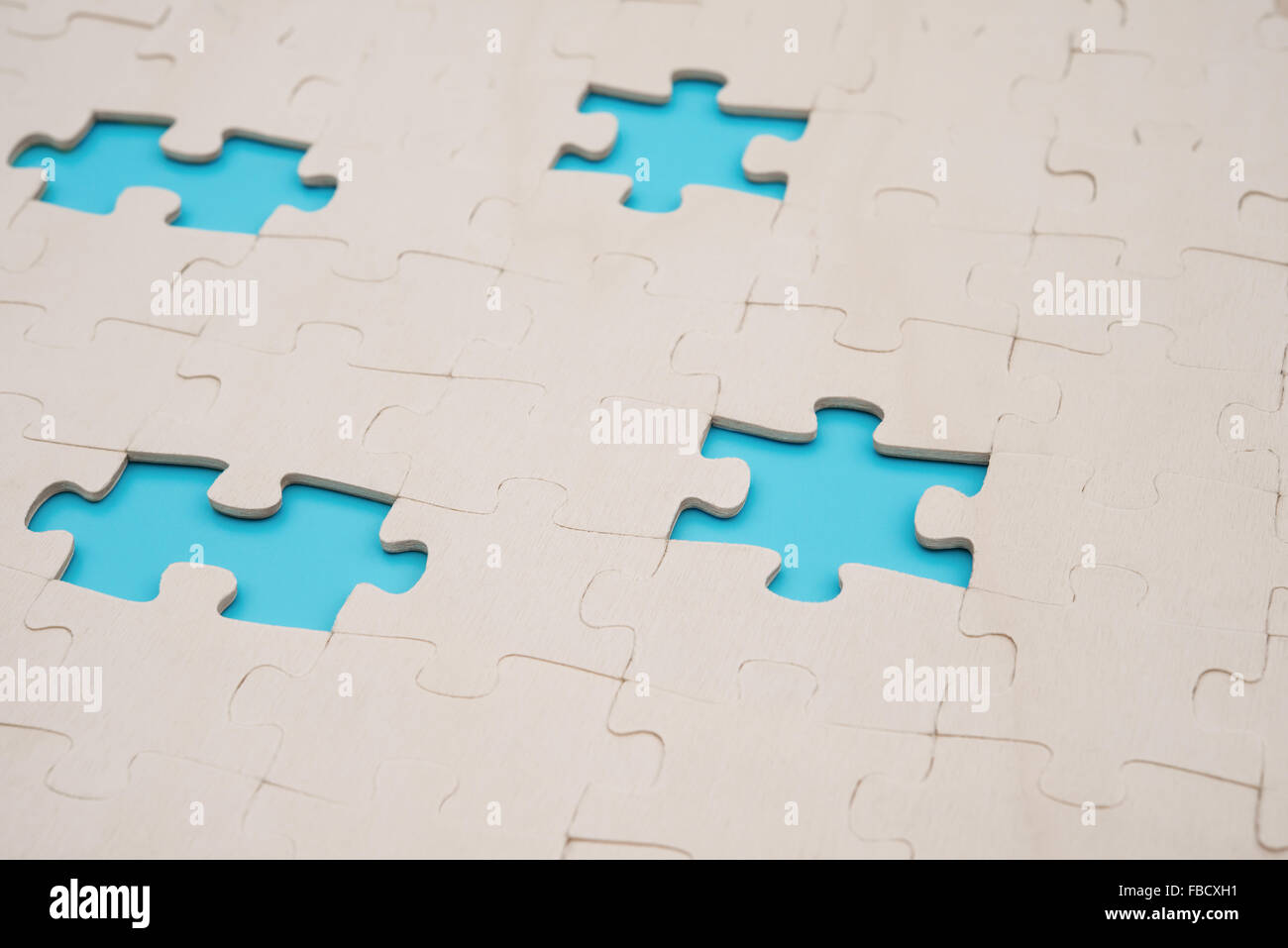 Jigsaw Puzzle With 4 Pieces Missed On Blue Background